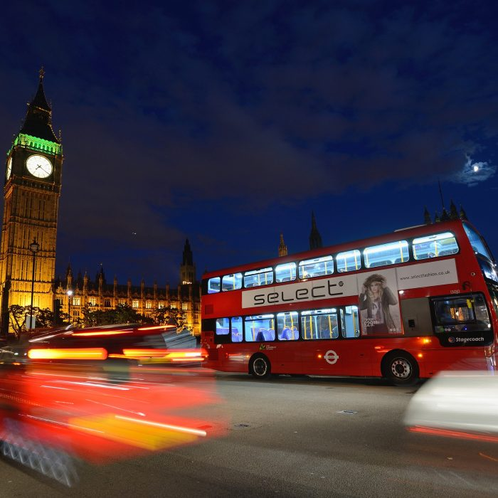 Night shot showing a London bus and Big Ben